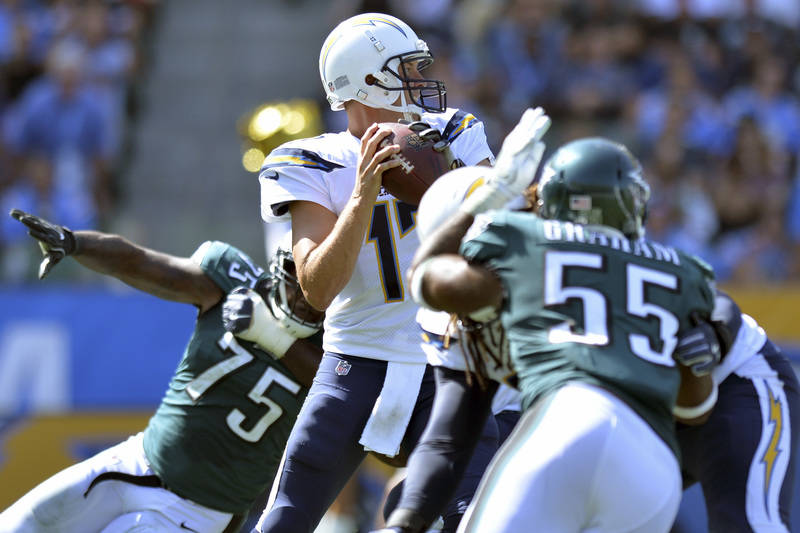 Oct 1, 2017; Carson, CA, USA; Los Angeles Chargers quarterback Philip Rivers (17) looks to pass under pressure during the second quarter against the Philadelphia Eagles at StubHub Center. Mandator ...