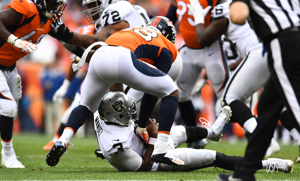 Oct 1, 2017; Denver, CO, USA; Denver Broncos outside linebacker Von Miller (58) sacks Oakland Raiders quarterback EJ Manuel (3) in the third quarter at Sports Authority Field at Mile High. Mandato ...