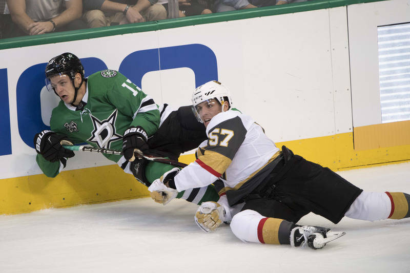 Oct 6, 2017; Dallas, TX, USA; Vegas Golden Knights left wing David Perron (57) checks Dallas Stars center Mattias Janmark (13) during the first period at the American Airlines Center. Mandatory Cr ...