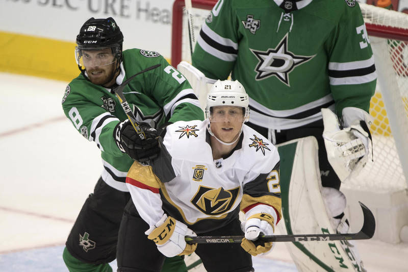 Oct 6, 2017; Dallas, TX, USA; Dallas Stars defenseman Stephen Johns (28) checks Vegas Golden Knights center Cody Eakin (21) during the first period at the American Airlines Center. Mandatory Credi ...