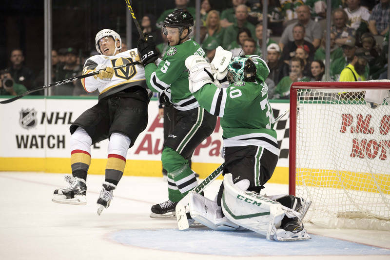 Oct 6, 2017; Dallas, TX, USA; Dallas Stars defenseman Jamie Oleksiak (5) checks Vegas Golden Knights left wing David Perron (57) during the second period at the American Airlines Center. Mandatory ...