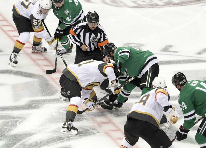 Oct 6, 2017; Dallas, TX, USA; Vegas Golden Knights center Cody Eakin (21) take the first face-off in team history against Dallas Stars center Tyler Seguin (91) at the American Airlines Center. The ...