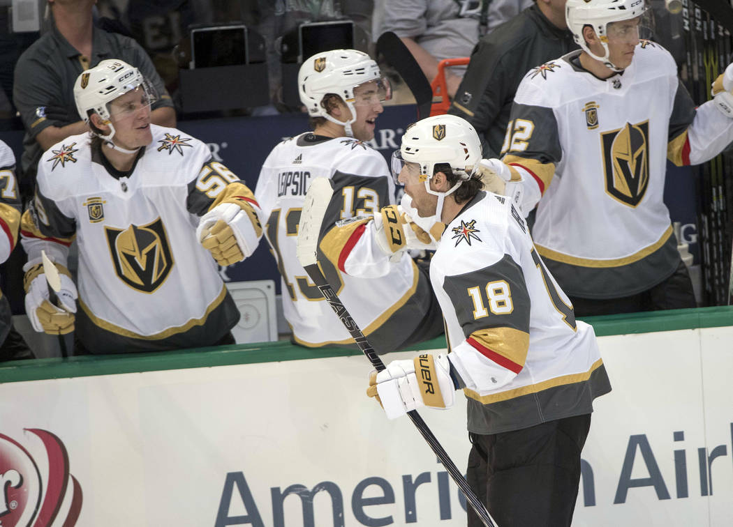 Oct 6, 2017; Dallas, TX, USA; Vegas Golden Knights left wing Erik Haula (56) and left wing Brendan Leipsic (13) and left wing James Neal (18) celebrate Neal scoring the first goal in team history  ...