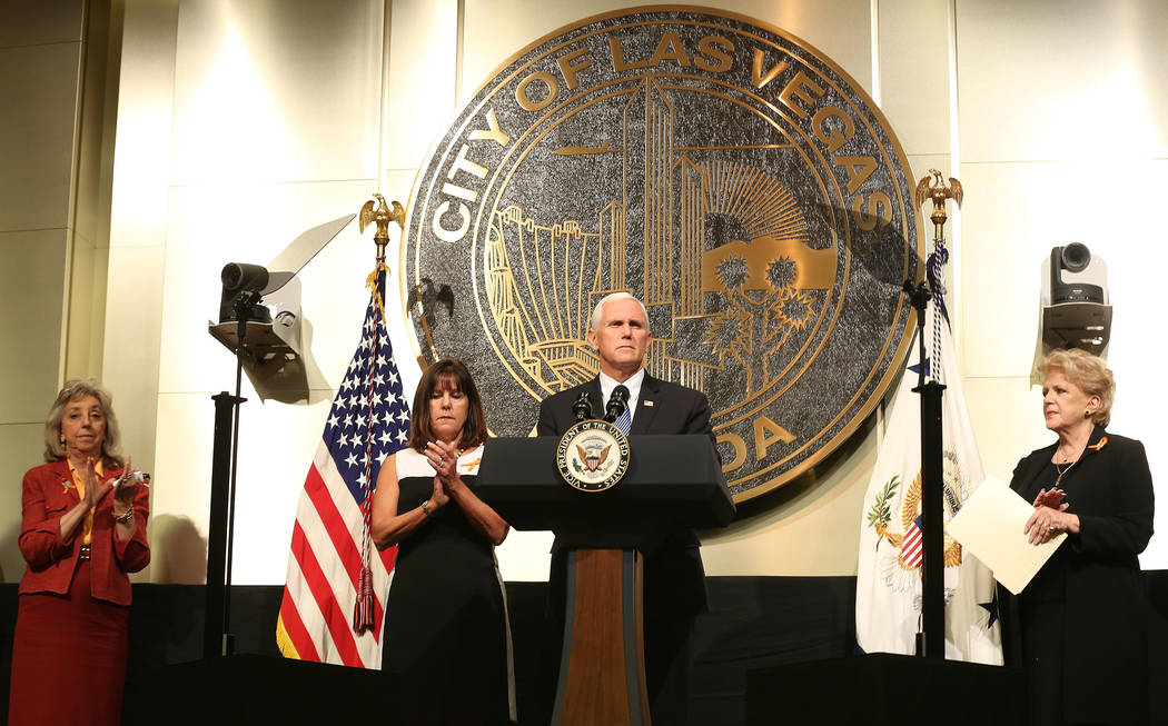 Vice President Mike Pence, with his wife Karen Pence, second from left, speaks following a unity prayer walk Saturday, Oct. 7, 2017, as Rep. Dina Titus, D-Nev., left, and Las Vegas Mayor Carolyn G ...