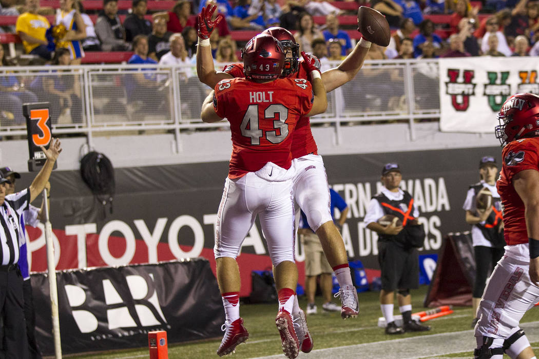 UNLV Rebels tight end Tim Holt (43) celebrates with tight end Trevor Kanteman (9) after Kanteman scored a touchdown during the second half of an NCAA college football game between the UNLV Rebels  ...