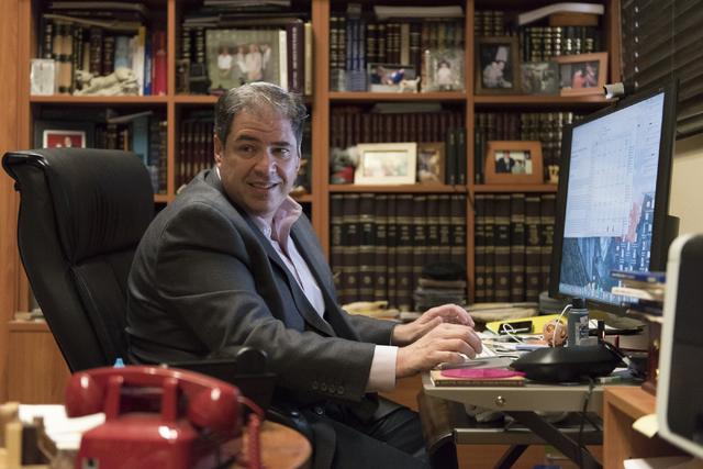 Rabbi Felipe Goodman works on his computer in this 2016 file photo. (Jason Ogulnik/Las Vegas Review-Journal)