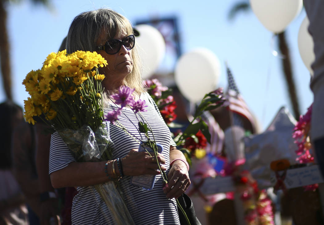 "Sharon Miller of Las Vegas visits a makeshift memorial for victims of Sunday's mass shooting near the ""Welcome to Fabulous Las Vegas"" sign in Las Vegas on Saturday, Oct. 7, 2017. ..."