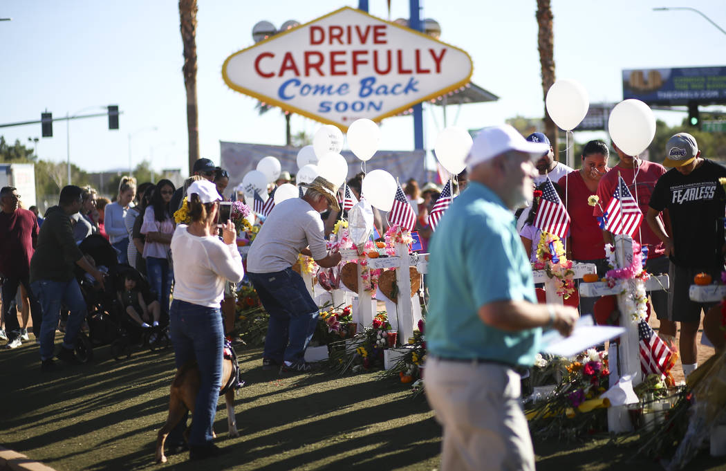 "People visit a makeshift memorial for victims of Sunday's mass shooting near the ""Welcome to Fabulous Las Vegas"" sign in Las Vegas on Saturday, Oct. 7, 2017. Chase Stevens Las Ve ..."