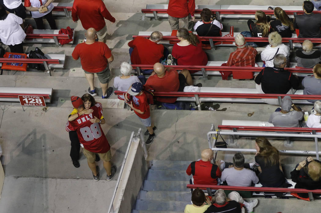 A UNLV fan hugs a member of the event staff before a football game between UNLV and San Diego State at Sam Boyd Stadium in Las Vegas on Saturday, Oct. 7, 2017. Chase Stevens Las Vegas Review-Journ ...