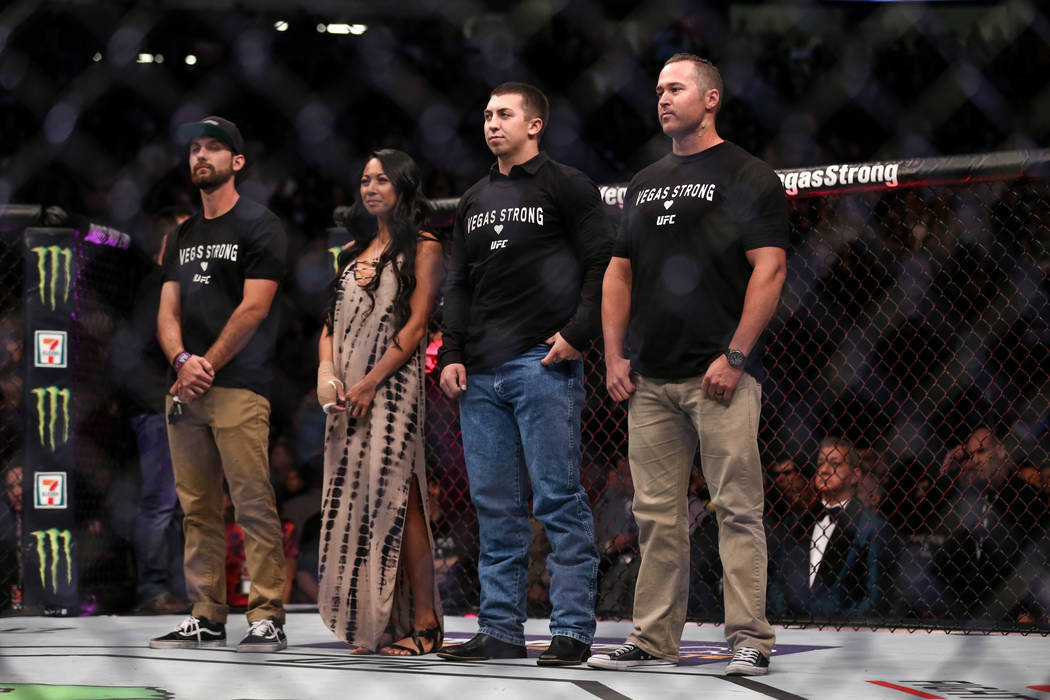 Parker Marx who was injured in Sunday night's shooting, from left, shooting victim Ashley Quiocho, Las Vegas police officer Brady Cook and injured Detective Casey Clarkson are honored during a cer ...