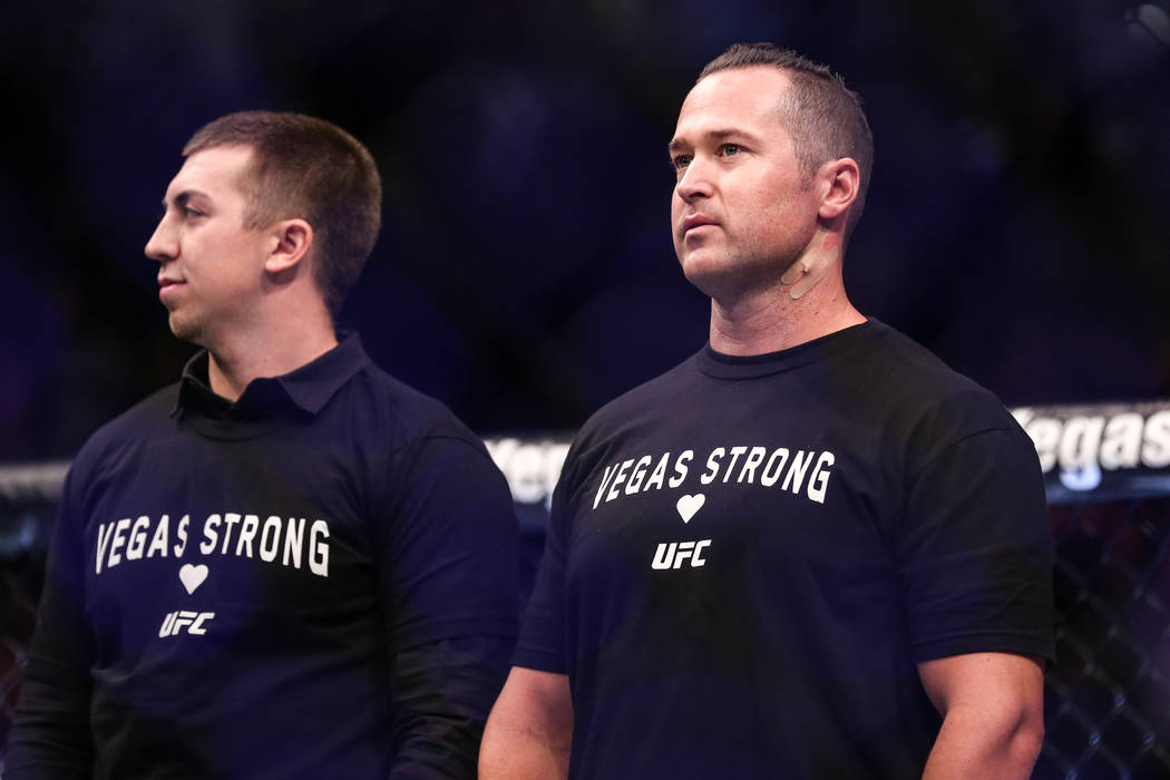 Las Vegas police officer Brady Cook, left, and injured Detective Casey Clarkson are honored along with other victims of Sunday night's mass shooting during a ceremony at UFC 216 at T-Mobile Arena  ...