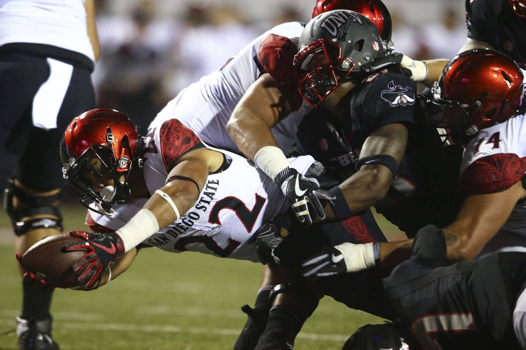 San Diego State's Chase Jasmin (22)  breaks through UNLV defense to score a touchdown during a football game at Sam Boyd Stadium in Las Vegas on Saturday, Oct. 7, 2017. Chase Stevens Las Vegas Rev ...