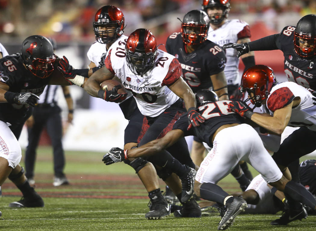 San Diego State's Rashaad Penny (20) tries to get through UNLV defense during a football game at Sam Boyd Stadium in Las Vegas on Saturday, Oct. 7, 2017. Chase Stevens Las Vegas Review-Journal @cs ...