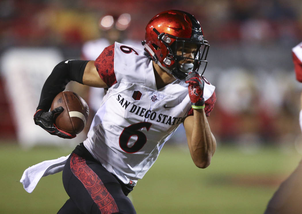 San Diego State's Mikah Holder (6) runs the ball against UNLV during a football game at Sam Boyd Stadium in Las Vegas on Saturday, Oct. 7, 2017. Chase Stevens Las Vegas Review-Journal @csstevensphoto
