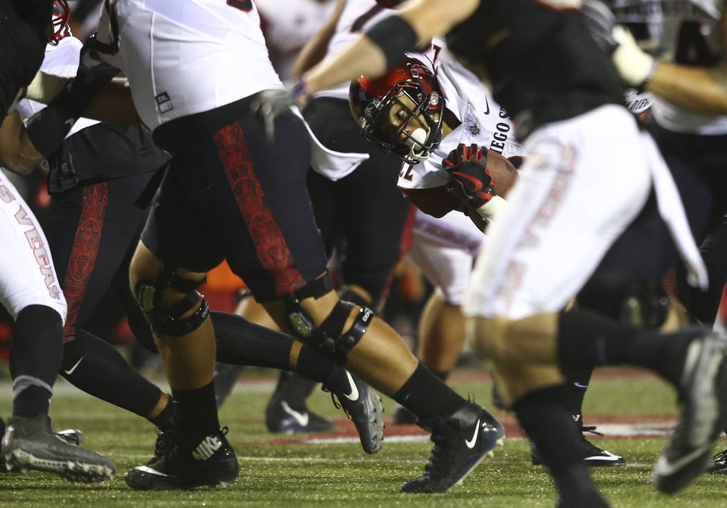 San Diego State's Chase Jasmin (22) runs the ball against UNLV during a football game at Sam Boyd Stadium in Las Vegas on Saturday, Oct. 7, 2017. Chase Stevens Las Vegas Review-Journal @csstevensphoto
