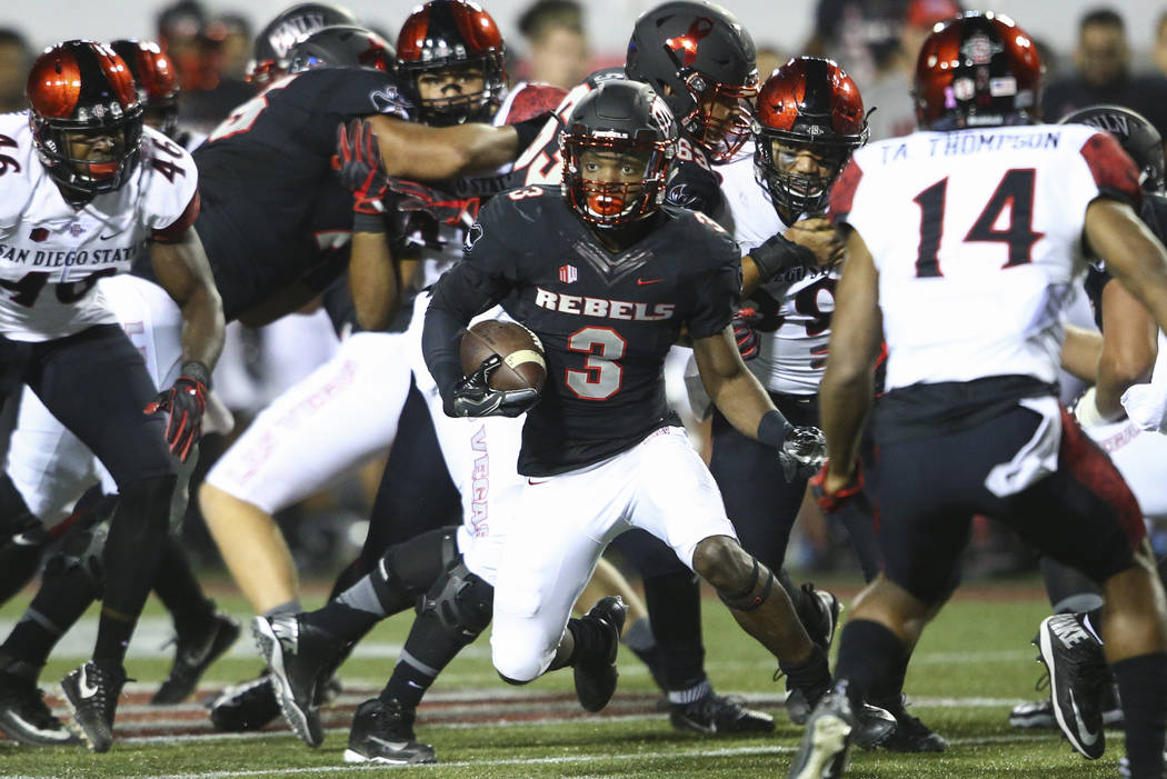 UNLV's Lexington Thomas (3) runs the ball against San Diego State during a football game at Sam Boyd Stadium in Las Vegas on Saturday, Oct. 7, 2017. Chase Stevens Las Vegas Review-Journal @cssteve ...