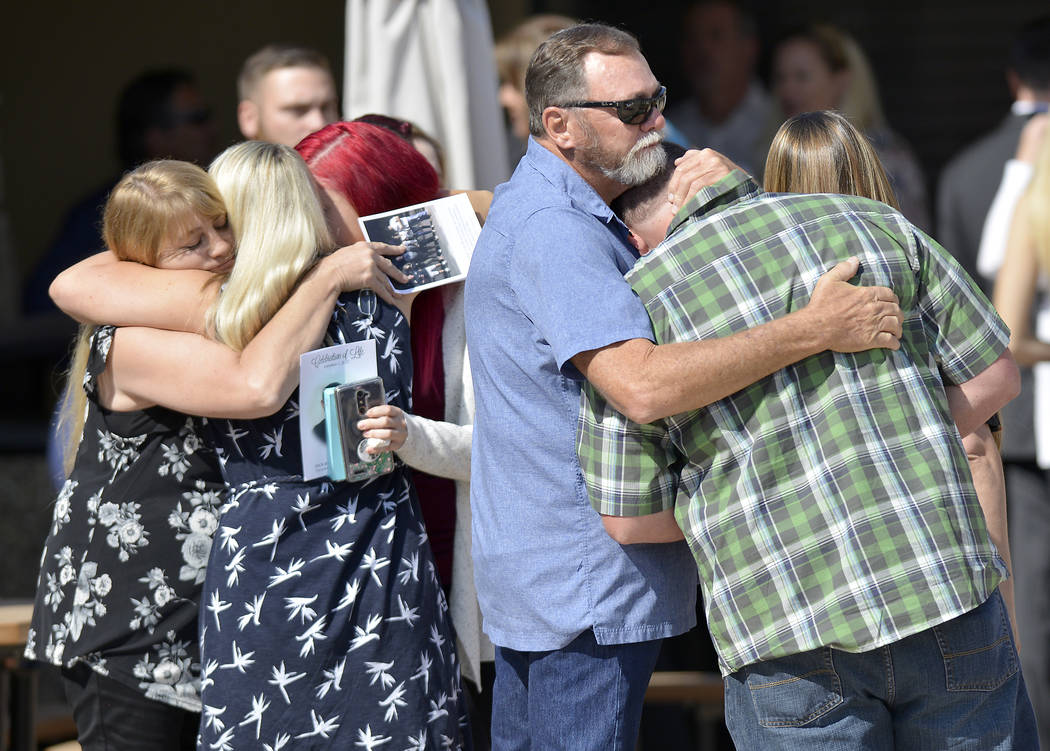 Mourners console each another after the memorial service for Jack Beaton at St. Elizabeth Ann Seton Catholic Church in Bakersfield, Calif., on Saturday, Oct. 7, 2017. Beaton was a victim of the Oc ...