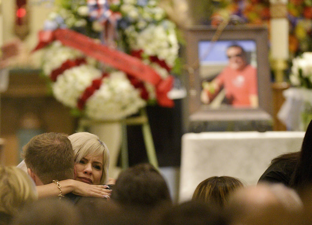 A mourner hugs family members during a memorial service for Jack Beaton at St. Elizabeth Ann Seton Catholic Church in Bakersfield, Calif., on Saturday, Oct. 7, 2017. Beaton was a victim of the Oct ...