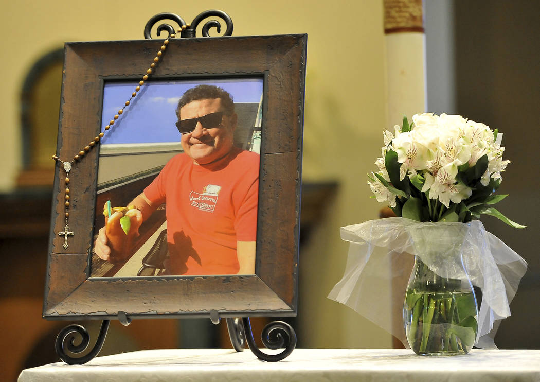 A photo of Jack Beaton on display next to a bouquet of flowers before his memorial service at St. Elizabeth Ann Seton Catholic Church Saturday, Oct. 7, 2017, in Bakersfield, Calif. Beaton was a vi ...