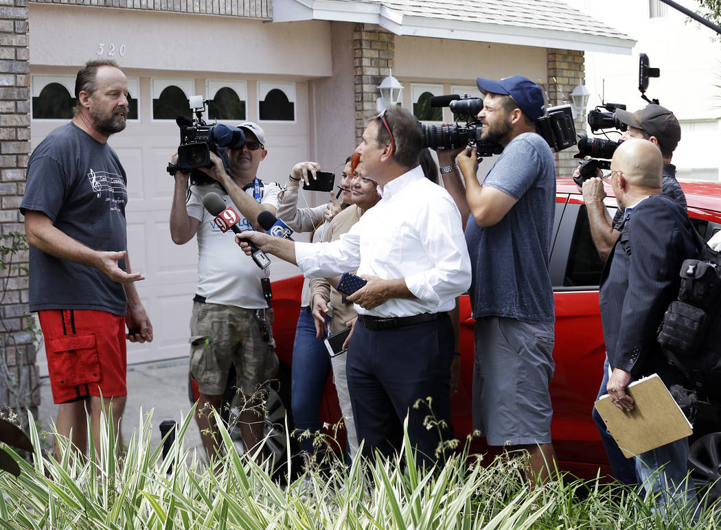 Eric Paddock, left, brother of Las Vegas gunman Stephen Paddock, speaks to members of the media outside his home, Monday, Oct. 2, 2017, in Orlando, Fla. Paddock told the Orlando Sentinel: &quo ...