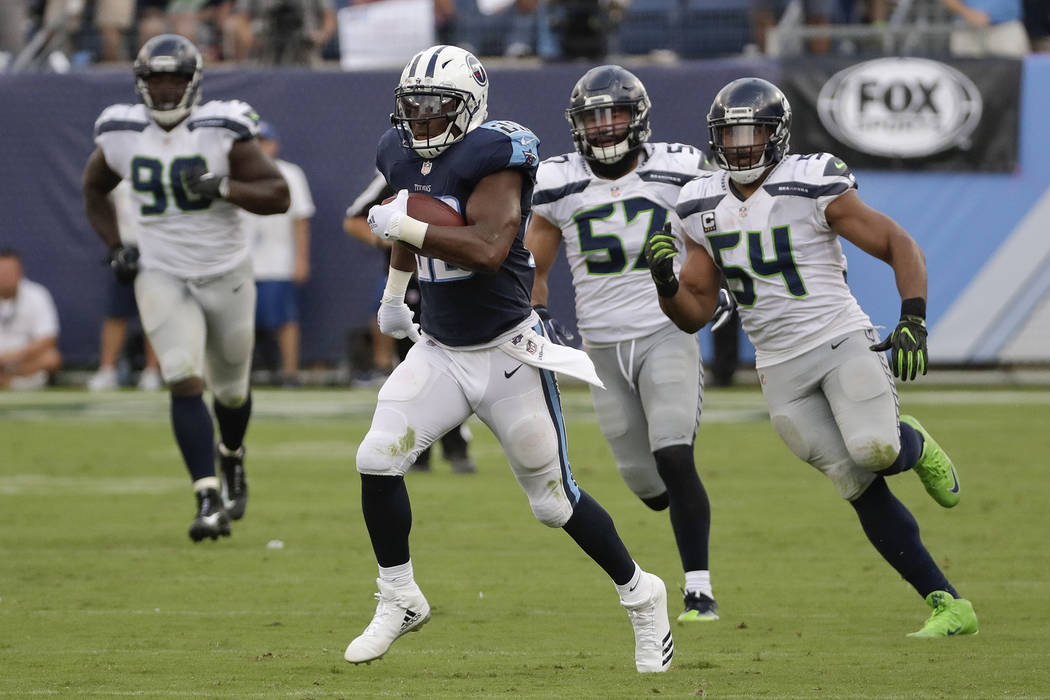 Tennessee Titans running back DeMarco Murray leaves Seattle Seahawks defenders behind as he scores a touchdown on a 75-yard run in the second half of an NFL football game Sunday, Sept. 24, 2017, i ...