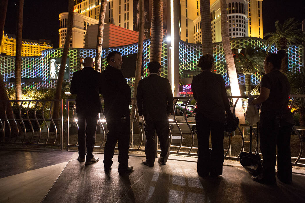 Hotel employees step outside to see marquees on the Strip go dark one week after the Oct. 1, 2017 mass shooting in Las Vegas, Sunday, Oct. 8, 2017. Bridget Bennett Las Vegas Review-Journal @Bridge ...