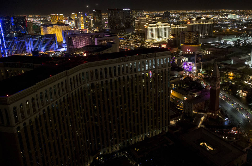 The Las Vegas Strip marquees go dark to honor the 58 victims who were killed during the mass shooting at the Route 91 Harvest Festival last week, Sunday, Oct. 8, 2017. Erik Verduzco/Las Vegas Revi ...