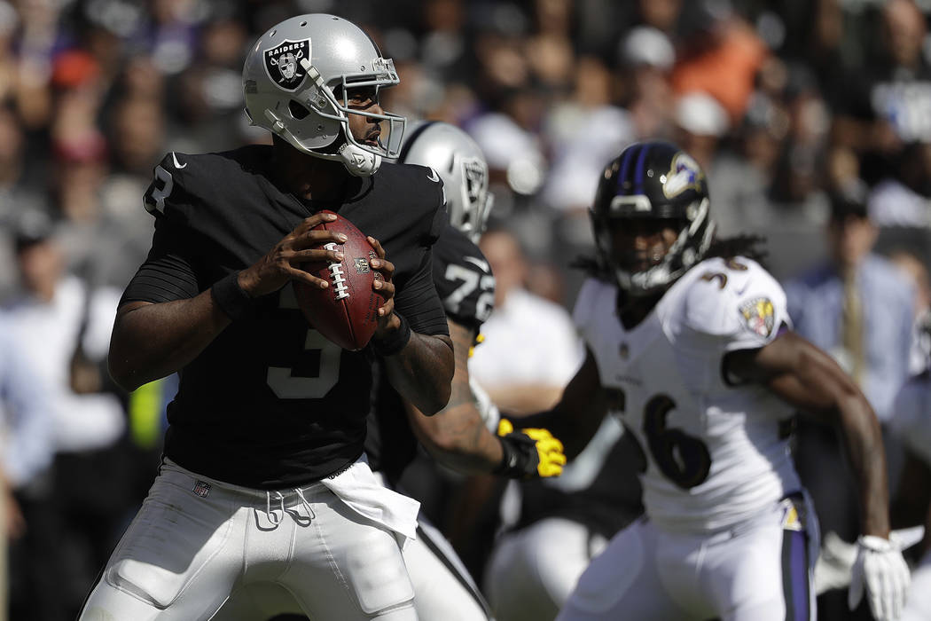 Oakland Raiders quarterback EJ Manuel (3) passes against the Baltimore Ravens during the first half of an NFL football game in Oakland, Calif., Sunday, Oct. 8, 2017. (AP Photo/Marcio Jose Sanchez)