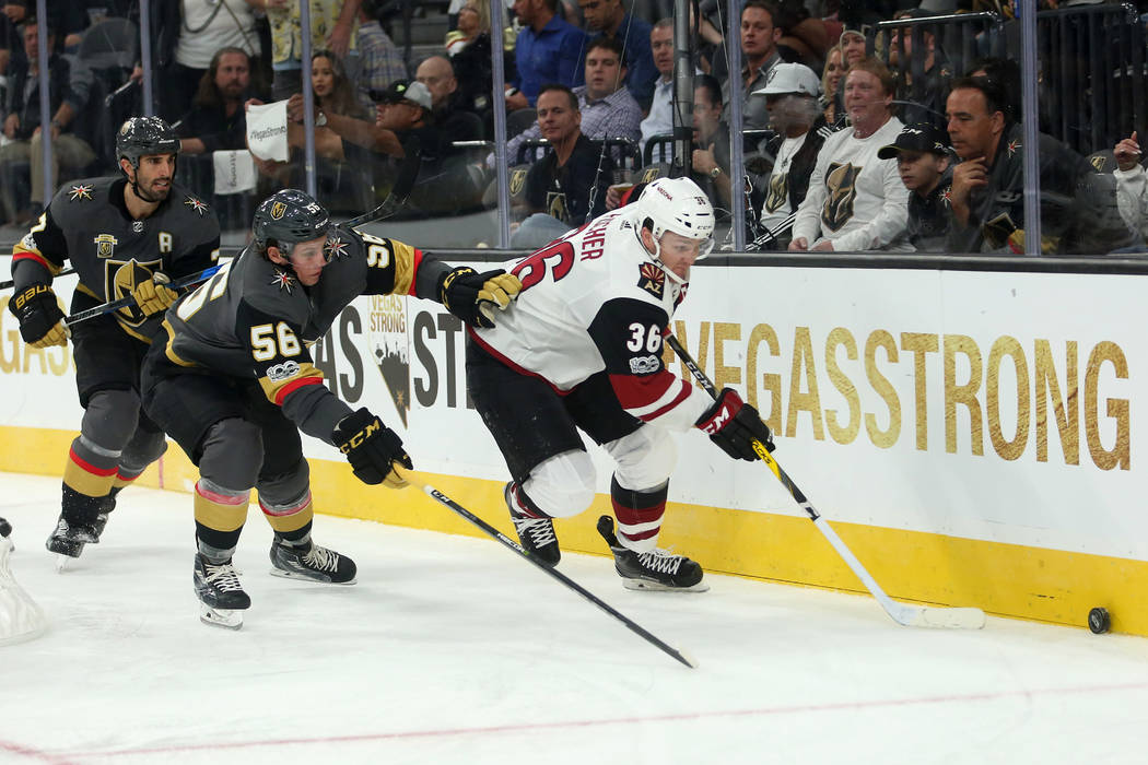 Vegas Golden Knights left wing Erik Haula (56) and Arizona Coyotes right wing Christian Fischer (36) chase after th puck during the third period against the Arizona Coyotes at T-Mobile Arena in La ...