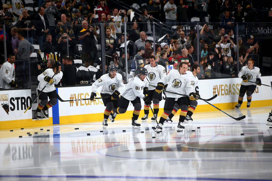The Vegas Golden Knights skate onto the ice before the start of an NHL hockey game against the Arizona Coyotes at T-Mobile Arena in Las Vegas on Tuesday, Oct. 10, 2017. Chase Stevens Las Vegas Rev ...