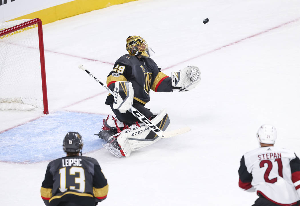 Vegas Golden Knights goalie Marc-Andre Fleury (29) makes a save during the first period of an NHL hockey game between the Vegas Golden Knights and the Arizona Coyotes, Tuesday, Oct. 10, 2017, at t ...