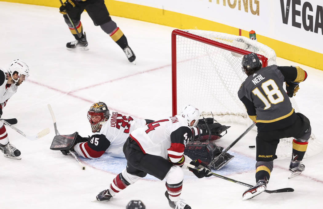 Vegas Golden Knights left wing James Neal (18) gets the puck past Arizona Coyotes goalie Louis Domingue (35) for a goal during the first period of an NHL hockey game between the Vegas Golden Knigh ...