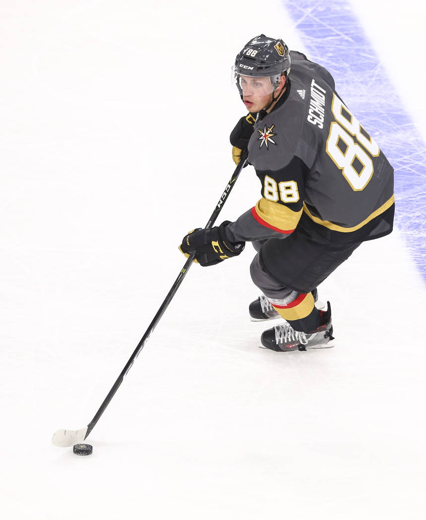 Vegas Golden Knights defenseman Nate Schmidt (88) controls the puck during the second period of an NHL hockey game between the Vegas Golden Knights and the Arizona Coyotes, Tuesday, Oct. 10, 2017, ...