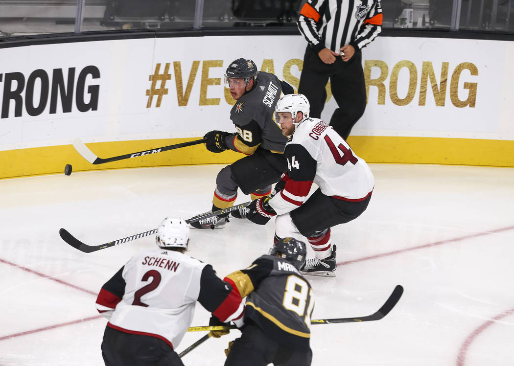 Vegas Golden Knights defenseman Nate Schmidt (88) and Arizona Coyotes defenseman Kevin Connauton (44) chase the puck during the second period of an NHL hockey game between the Vegas Golden Knights ...
