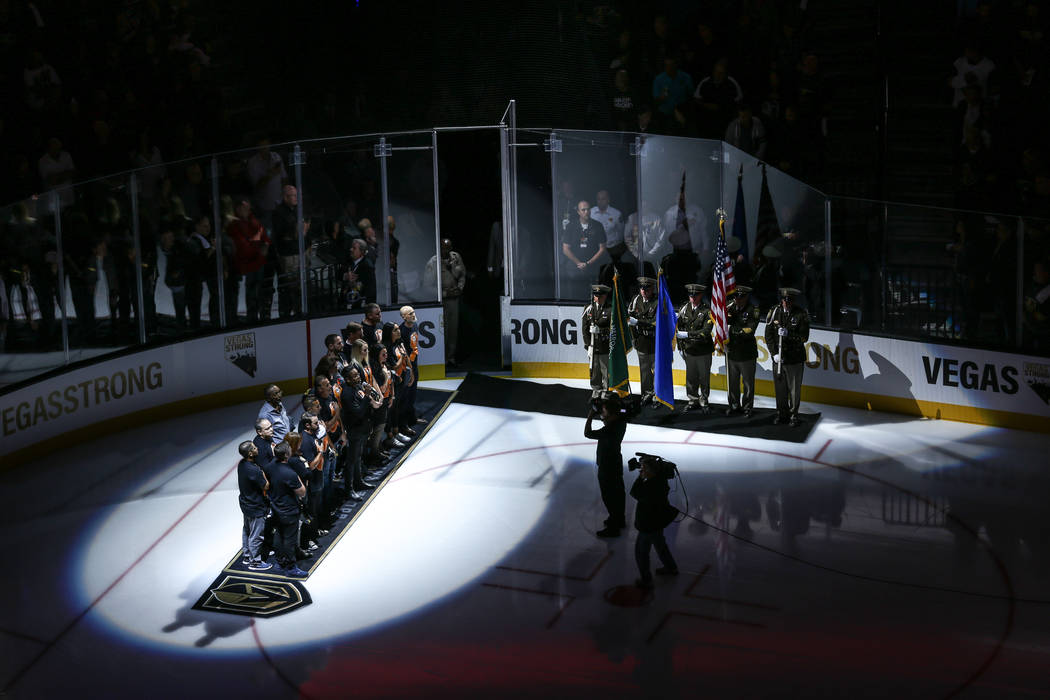 A ceremony honoring victims and first responders of the Route 91 Harvest Festival shooting before the start of an NHL hockey game between the Vegas Golden Knights and the Arizona Coyotes at T-Mobi ...