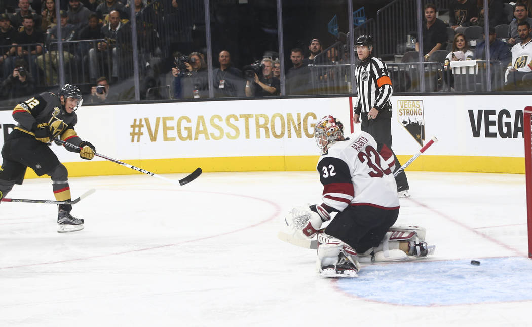 Vegas Golden Knights' Tomas Nosek (92) scores the first goal of the night against Arizona Coyotes goalie Antti Raanta (32) during an NHL hockey game at T-Mobile Arena in Las Vegas on Tuesday, Oct. ...
