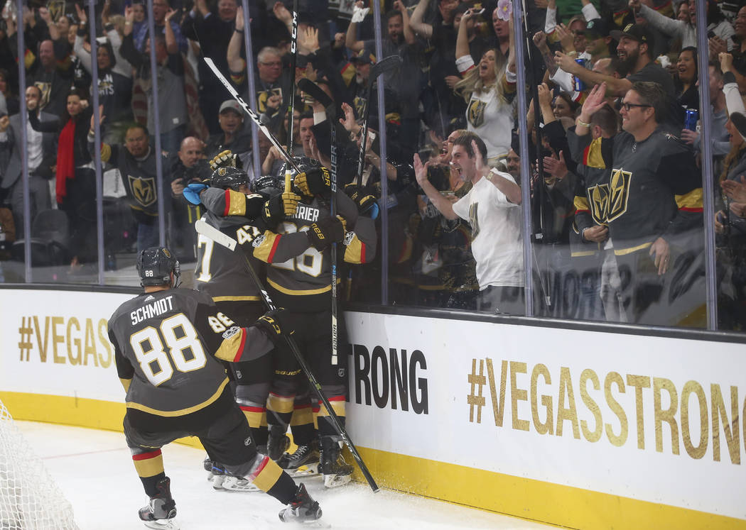 Vegas Golden Knights players celebrate the first goal of the night, by Tomas Nosek, against the Arizona Coyotes during an NHL hockey game at T-Mobile Arena in Las Vegas on Tuesday, Oct. 10, 2017.  ...