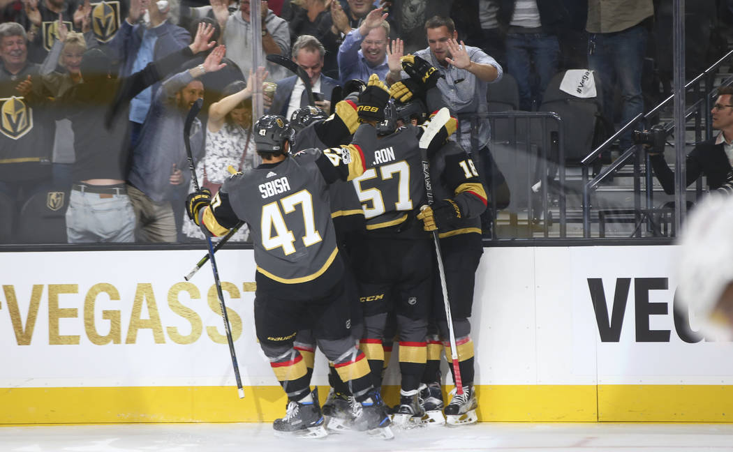 Vegas Golden Knights players celebrate a goal by James Neal against the Arizona Coyotes during an NHL hockey game at T-Mobile Arena in Las Vegas on Tuesday, Oct. 10, 2017. Chase Stevens Las Vegas  ...