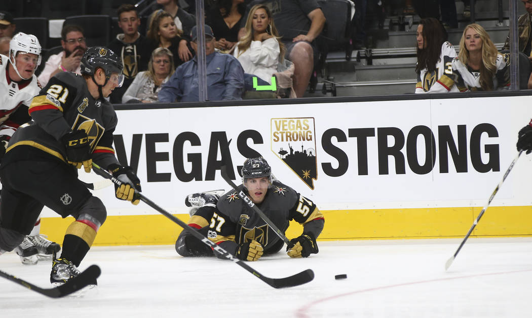 Vegas Golden Knights David Perron (57) and Cody Eakin (21) go after the puck against the Arizona Coyotes during an NHL hockey game at T-Mobile Arena in Las Vegas on Tuesday, Oct. 10, 2017. Chase S ...