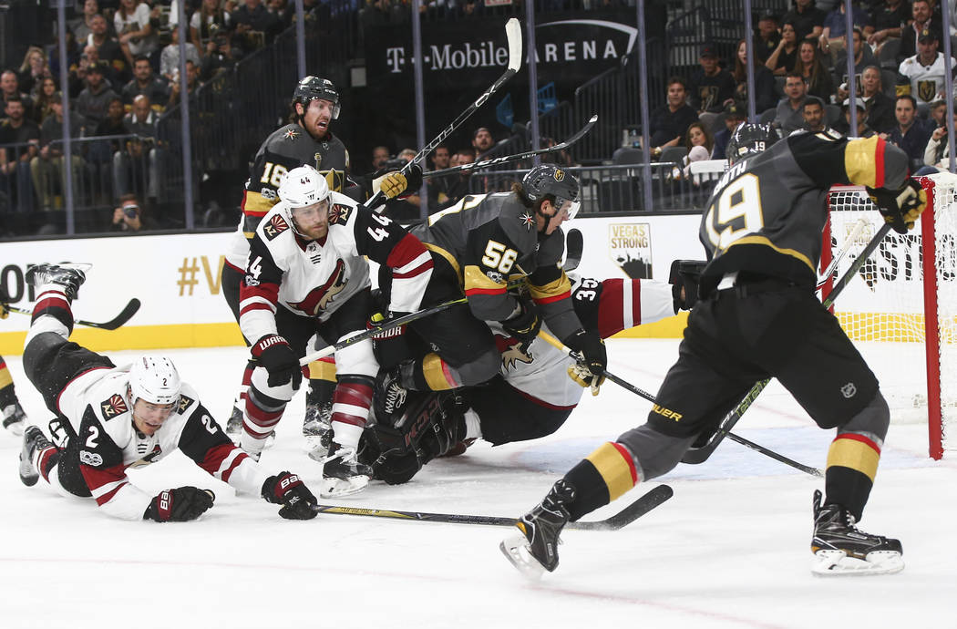 Vegas Golden Knights players attempt to score against the Arizona Coyotes during an NHL hockey game at T-Mobile Arena in Las Vegas on Tuesday, Oct. 10, 2017. Chase Stevens Las Vegas Review-Journal ...