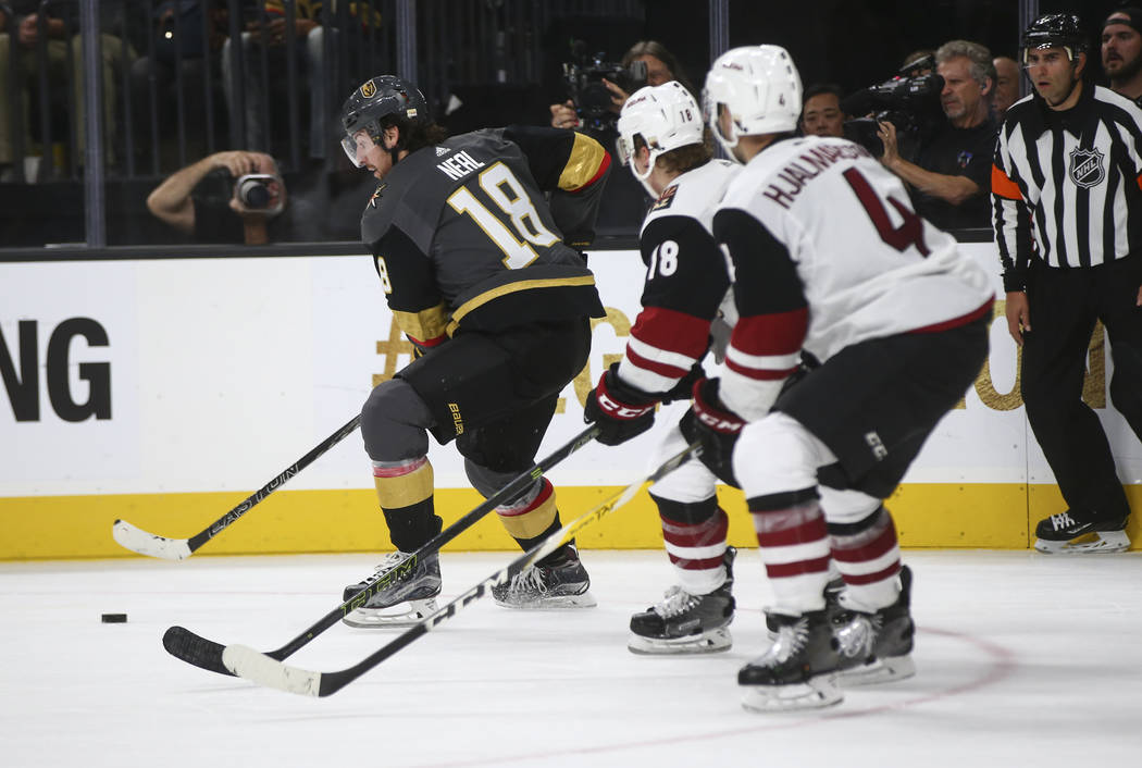 Vegas Golden Knights' James Neal (18) moves the puck as Arizona Coyotes defenders follow during an NHL hockey game at T-Mobile Arena in Las Vegas on Tuesday, Oct. 10, 2017. The Golden Knights won  ...