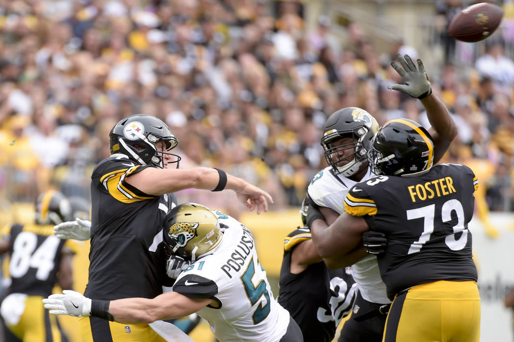 Pittsburgh Steelers quarterback Ben Roethlisberger (7) gets a pass away as he is hit by Jacksonville Jaguars middle linebacker Paul Posluszny (51) in the first half of an NFL football game, Sunday ...