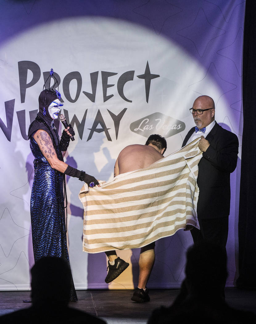 "Hosts Tracy Skinner, ""Mother Loosy Lust Bea Lady,"" left, and Jim McCoy shield a model as he changes during ""Project Nunway,"" a fundraiser fashion show for The Holy Order Sin Sity Sisters of Perpet ..."