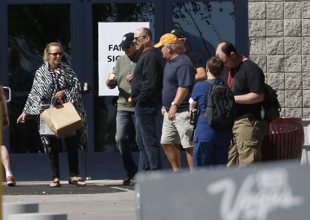 People leave the Family Assistance Center at the Las Vegas Convention Center where survivors of last week's deadly Las Vegas shooting retrieve their belongings, Monday, Oct. 9, 2017. Bizuayehu Tes ...
