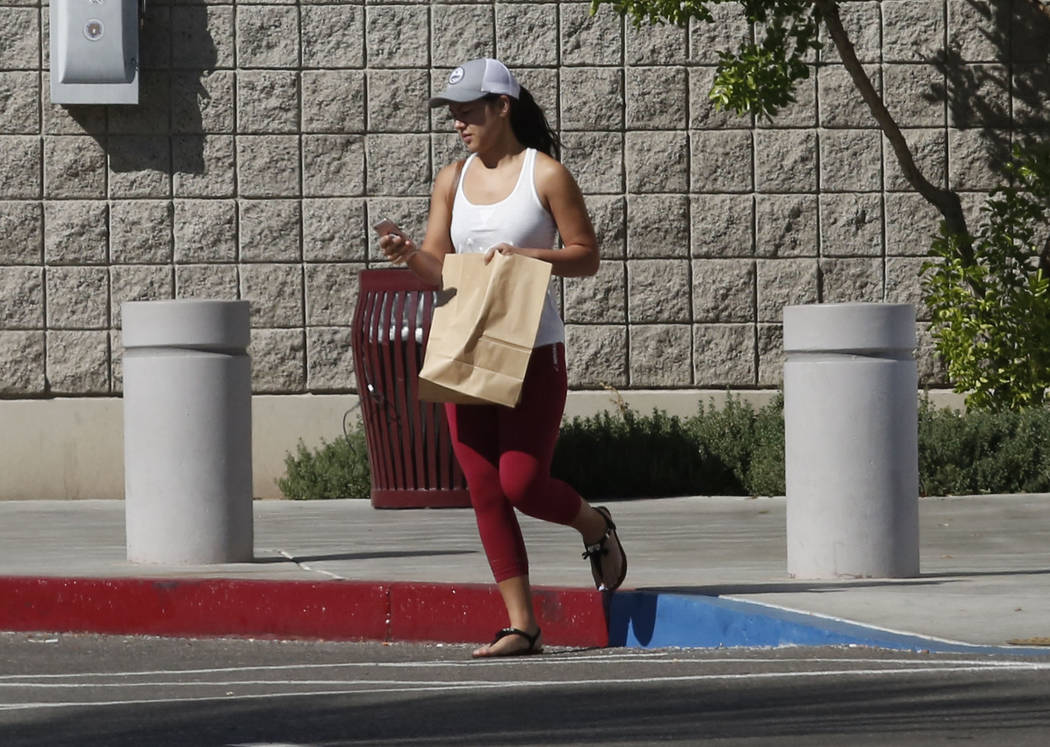 A woman leaves the Family Assistance Center at the Las Vegas Convention Center where survivors of last week's deadly Las Vegas shooting retrieve their belongings, Monday, Oct. 9, 2017. Bizuayehu T ...