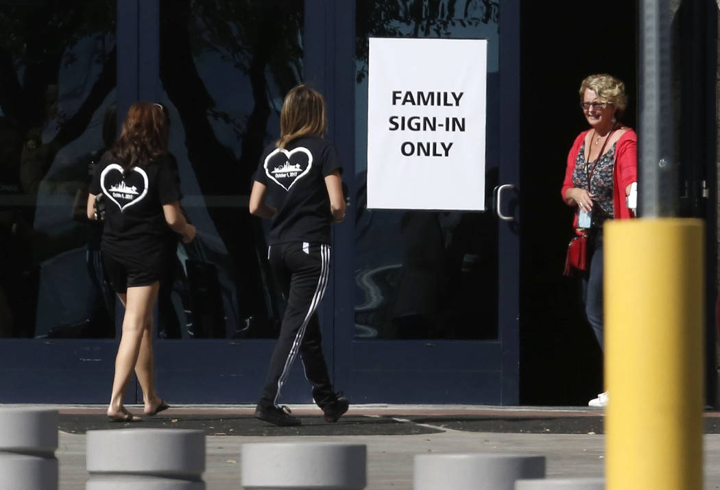 People arrive at the Family Assistance Center at the Las Vegas Convention Center where survivors of last week's deadly Las Vegas shooting retrieve their belongings, Monday, Oct. 9, 2017. Bizuayehu ...