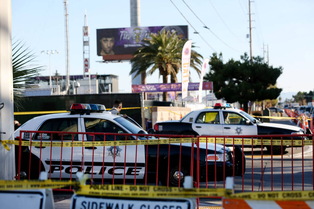 Las Vegas police cars guard the Route 91 Harvest Festival grounds in Las Vegas, Saturday, Oct. 7, 2017, while FBI collect belongings left by those who attended the festival the night of the shooti ...