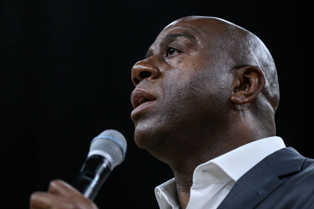 Former Los Angeles Lakers' Magic Johnson speaks honoring the victim's of last week's mass shooting during the opening of a preseason basketball game between the Los Angeles Lakers and the Sacramen ...