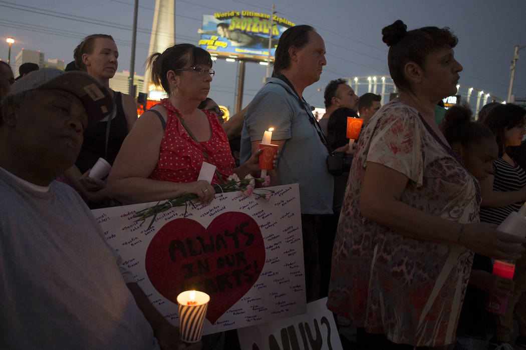 Attendees gather for vigil in honor of the victims exactly one week after the Oct. 1, 2017 mass shooting on the corner of Sahara Avenue and Las Vegas Boulevard in Las Vegas, Sunday, Oct. 8, 2017.  ...