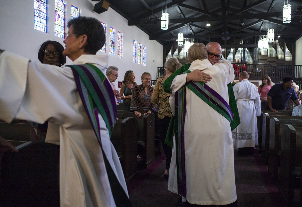 The Rev. Barry Vaughn, Rector, right, is embraced after a service at Christ Church Episcopal in Las Vegas on Sunday, Oct. 8, 2017. Chase Stevens Las Vegas Review-Journal @csstevensphoto